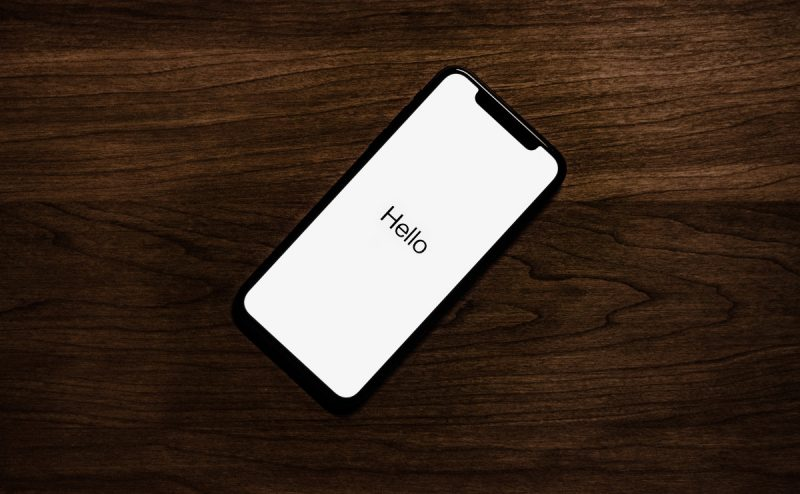 iPhone with 'Hello' message