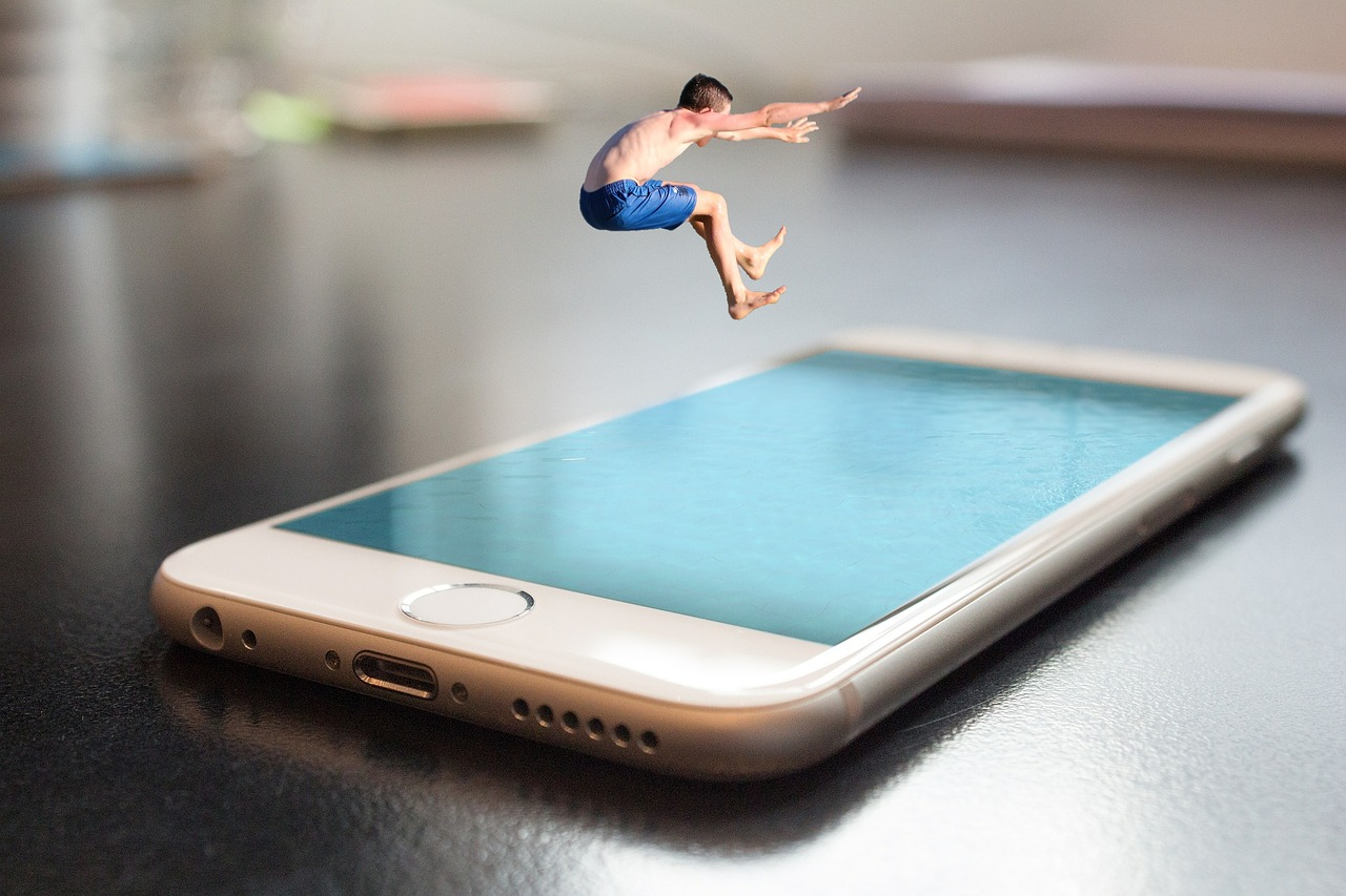 Kid jumping into smartphone