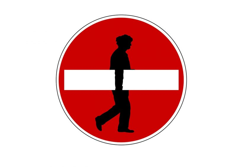 Man carrying no entry sign