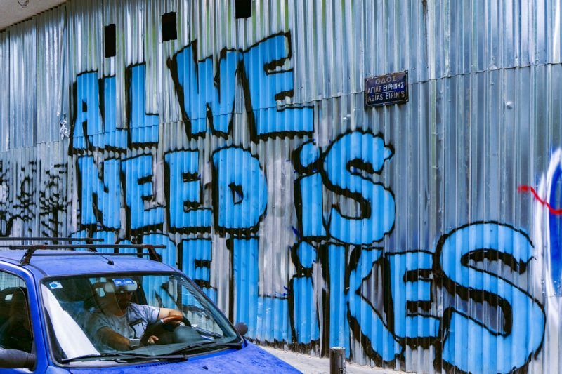 "Graffiti saying ""All we need is more likes"""