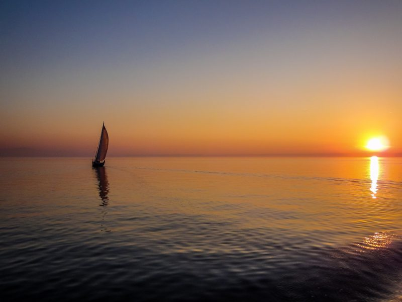 Sailing boat at sunset