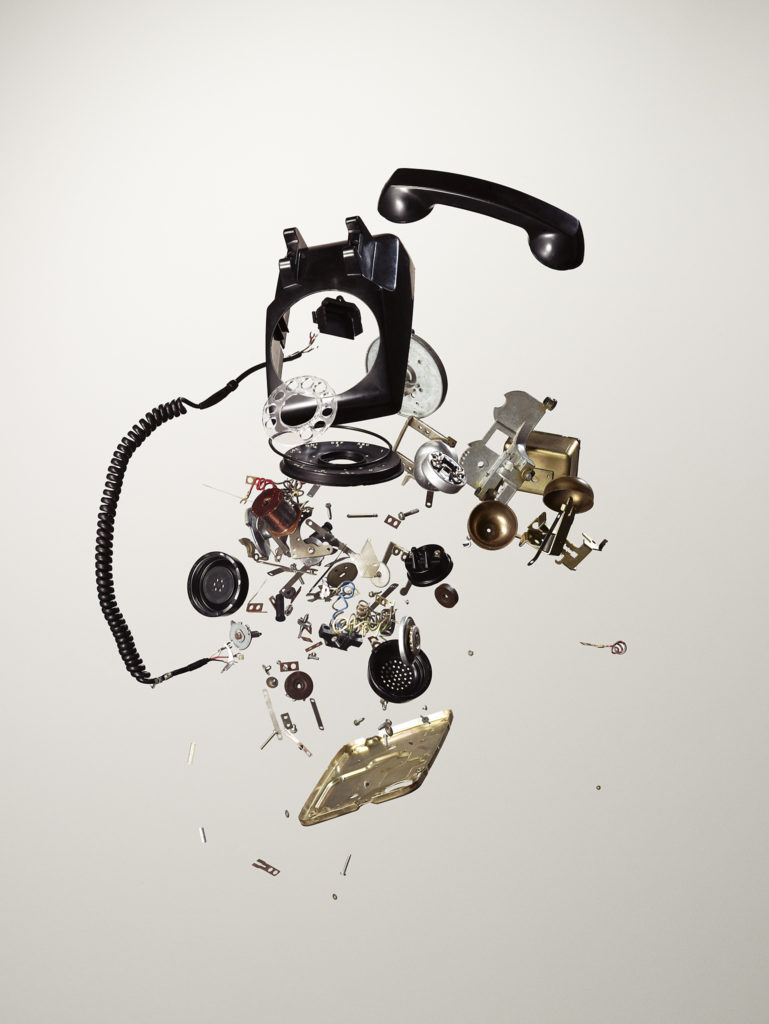 Exploded image of old rotary phone